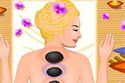 Une fille se fait masser avec des pierres chaudes